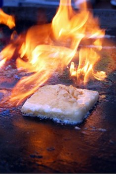 Cheese ― see how it burns! - STACY POULOS/POSTCARDTRAVELERS.COM
