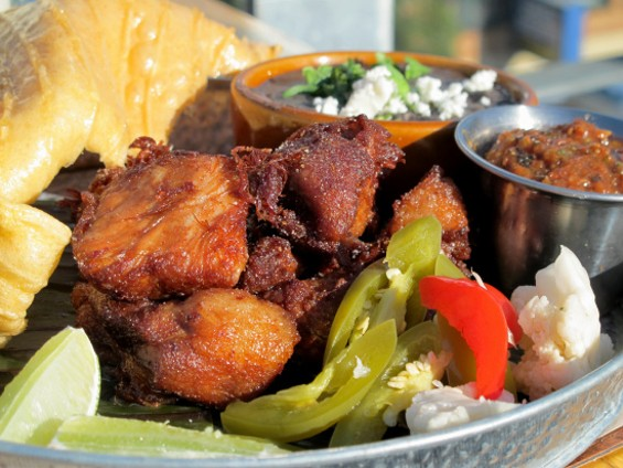 Chicharrones de Carne are deliciously crisp and fatty - LOU BUSTAMANTE