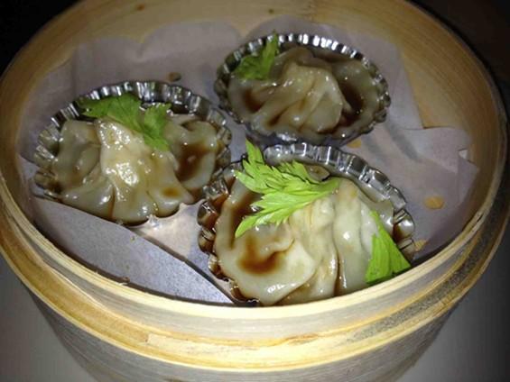 Chicken and black truffle soup dumplings by American Bao Bar. - TAMARA PALMER