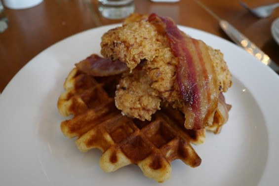 Chicken and Waffles, topped with bacon and maple syrup