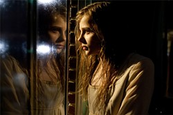 Chloe Moretz plays a waifish, home-school-creepy vampire kid.