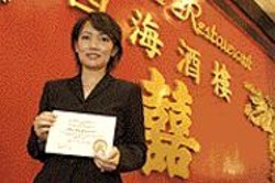 ANTHONY  PIDGEON - City officials will issue special cleanliness - certificates - like this one held by Four Seas Restaurant - owner Sara - Lim.