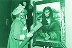 "PAUL  TRAPANI - Clowning Around: Master ""artist"" Spaghetti paints a seductive grin on Bobo's Mona Lisa."