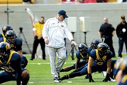 AP PHOTO/MARCIO JOSE SANCHEZ - Coach Tedford leading warm-ups during the 2012 Big Game. Stanford won 21-3.