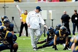 AP PHOTO/MARCIO JOSE SANCHEZ - Coach Tedford leading warm-ups during the 2012 Big Game. Stanford won 21-3.