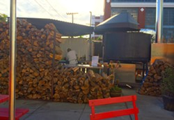 The oven and its woodpile. - PETE KANE