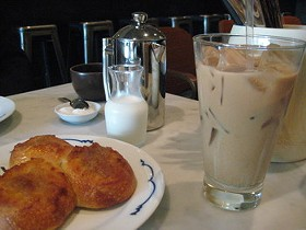 Coffees, with coconut-jam-filled pull bread. - M. BRODY