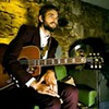 Comedian Nick Thune Sports Guitar, Occasional Beard
