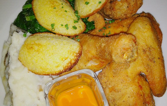 Cornbread madelines and Crystal butter accompany fried chicken at Fish & Farm. - CHRISTINA SPITTLER