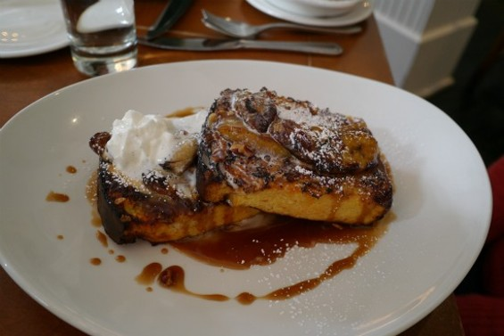 Cornflake Crusted Brioche French Toast with caramelized bananas, whipped cream, pecans and bourbon caramel