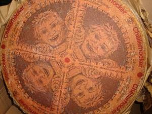 Creepy faces adorn wheels of Chällerhocker, a Swiss cow's milk cheese. - GORDON EDGAR