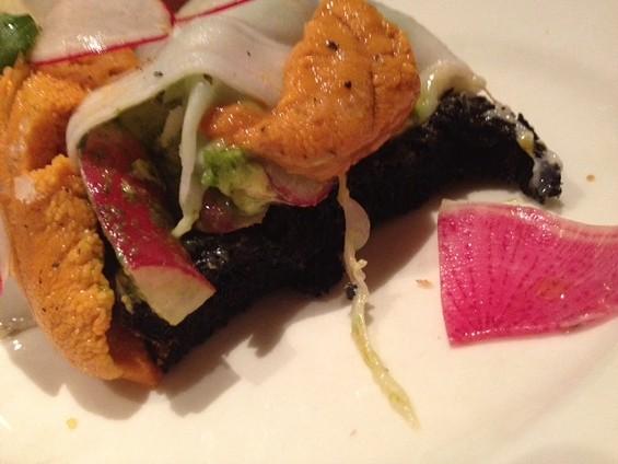 Cross-section of black bread by Incanto. - TAMARA PALMER