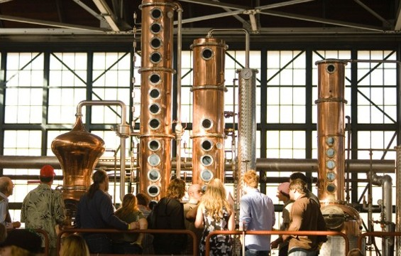 Customers on a tour at St. George Spirits. - FLICKR/CHARLES HAYNES