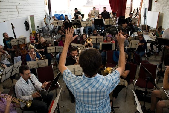 David Möschler conducting the Awesöme Orchestra Collective, which will perform the title track at Stand! this Friday, Saturday, and Sunday.