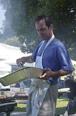 SUSIE  SMITH - Delfina owner Craig Stoll works his tongs.