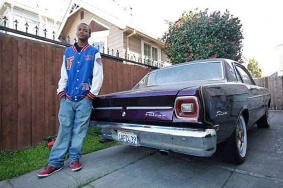Diallo Neal Jr. and the '68 Falcon his dad fixed up. - ANNA LATINO