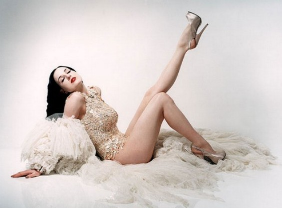 Dita channels the retro glamour of a pin-up girl, snatching styles from a slew of eras.