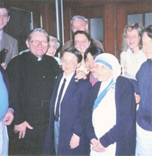 Donald McGuire, pictured with an alleged victim and Mother Teresa in 1991