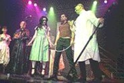 JAMES  SANDERS - Dr. Kingfish (right) presents some of the deceased - delectables in the zombie parade.