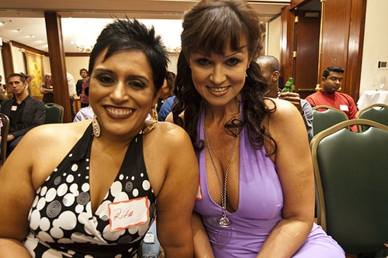 """Drool Brittania: British cougars Rita Sangha (left), 39, and Bea Cameron, 45, make nice to the camera during August's """"National Cougar Convention"""" - DANIEL C. BRITT"""
