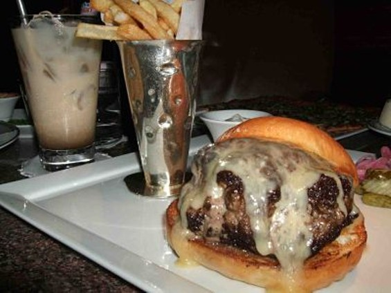 Duck fat burger (D.F.B.), fries, and Iced Laced coffee ($20 on Sunday and Monday nights). - TAMARA PALMER