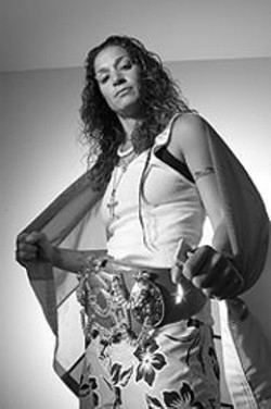 PAOLO  VESCIA - During her kickboxing career, - Ramona Gatto - accumulated more world titles than - any other woman - fighter.