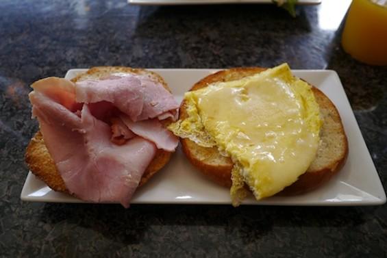 Egg sandwich with Boar's Head ham, basil aioli and cheddar cheese