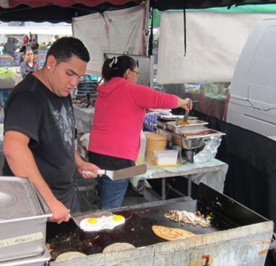 El Huarache Loco workers make breakfast