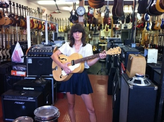 Eleanor Friedberger and the new guitar she got last Thursday. (Really.)