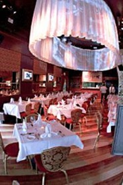 JAMES  SANDERS - Enjoy New Orleans nightlife projected on - screens and curtains while you relish the - city's cuisine.