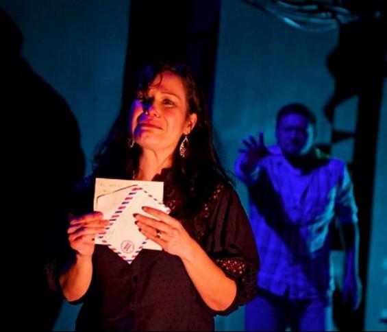 Esme weeps for her dead husband Luis.