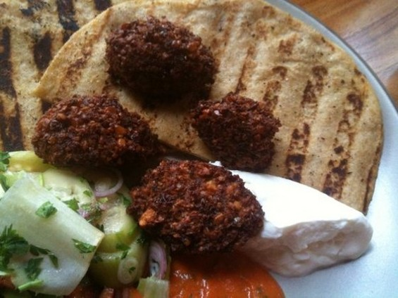 Falafel with spicy cucumbers, yogurt, and grilled pita, $11, at Zut! - JOHN BIRDSALL