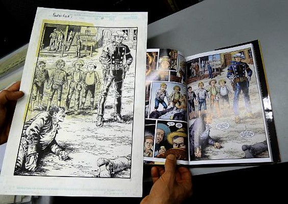 Farago compares an original ink drawing to how it appears in the comic book.