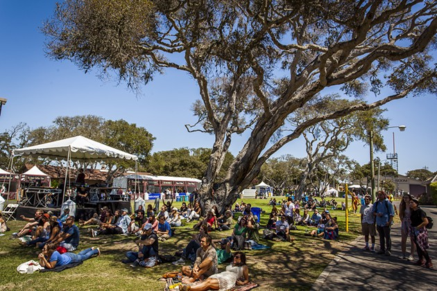 A chill crowd watches Midi Matilda at the grassy Monterey County Fairgrounds. - ASA MOORE