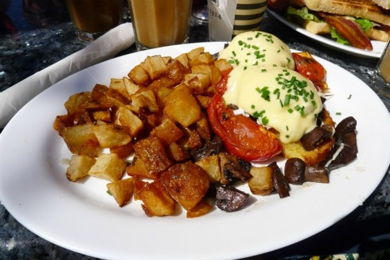 Flore Benedict: poached eggs, oven-roasted tomatoes, mushroom ragout, homemade cornbread, hollandaise and garlic fried potatoes