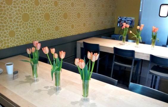 Flour & Co's tulip-adorned interior. - PETE KANE