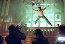 KERRY  HAYES/SMPSP - Flying Wolverine: Hugh Jackman rips up bad guys -- - when he's not suffering the nightmares of his dubious - origin.