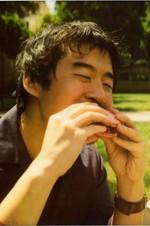 Francis Lam, enjoying street food.