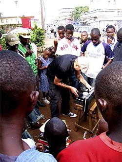 AMADOU BALDÉ - Frank Gossner testing vinyl in Freetown.