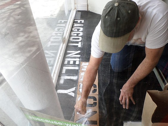Frank Pietronigro at work in the Johnston Gallery window. - DAVID-ELIJAH NAHMOD