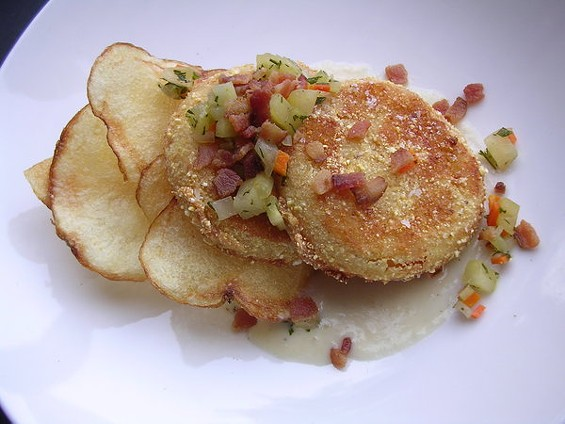 Fried green tomatoes with bacon and sauce soubise. - JOHN BIRDSALL