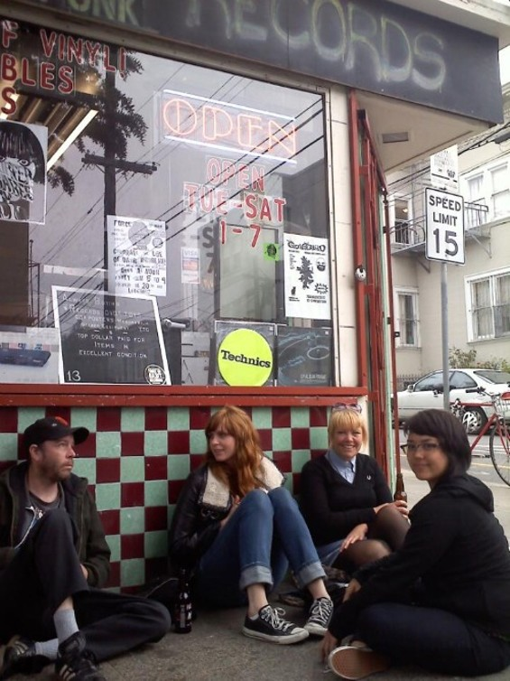 Friends hang out outside Force of Habit to remember Devereaux. - MICHAEL CHAPPELL