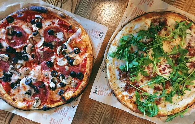 From L-R: a build it yourself pizza with spicy red sauce and a white pie - BETTY WANG