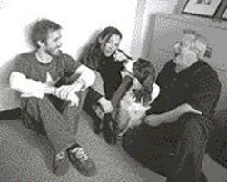 AKIM  AGINSKY - From left to right: Allen Scott, Sherry - Wasserman, and Gregg Perloff train their - dog to laugh in the face of Clear Channel.