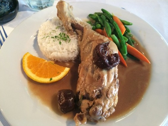 Galinha na cerveja (a quarter-chicken marinated in dark beer, with Brazilian spices and stewed prunes) - PETE KANE