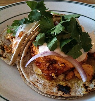 Global Soul's salmon tacos with cilantro crema.