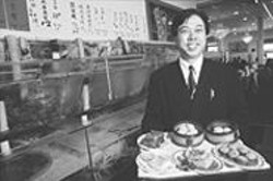 ANTHONY  PIDGEON - GM Eric Lau with a selection of dim sum plates.