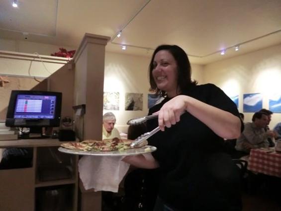 Goat Hill Pizza's Sarah Stanford serves up a veggie combo. - ALEX HOCHMAN