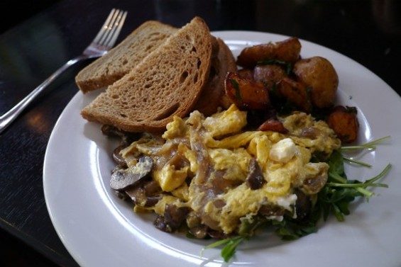 Greek scramble, with olives, mushrooms, spinach, and feta