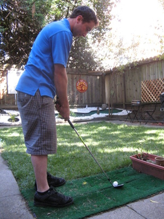 Greenskeeper Joseph Frankel tees off in his backyard